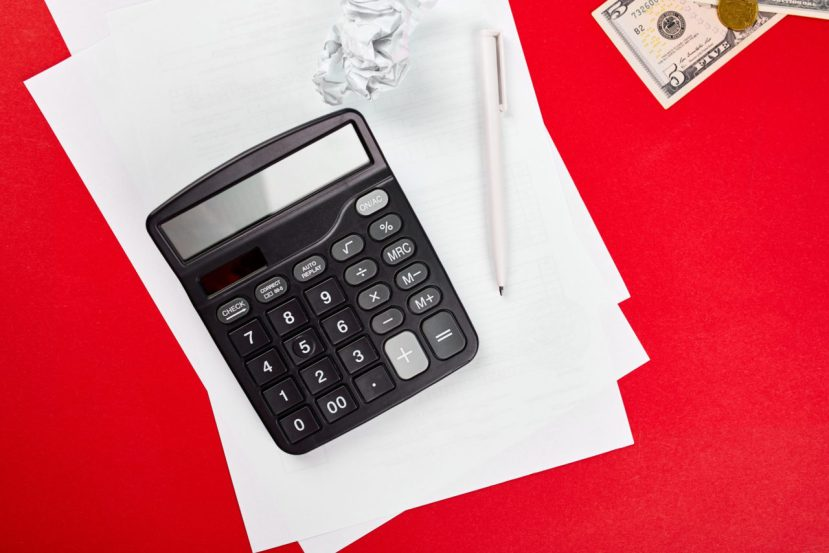 Concept of planning of the budget, business, finance planning, saving money, taxes or accounting concept, bankruptcy, Top view or flat lay money, calculate, list and pen on red background.