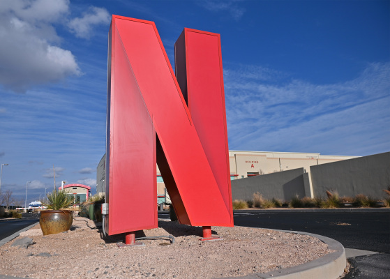 ALBUQUERQUE, NEW MEXICO - NOVEMBER 23: The Netflix logo is displayed at the entrance to Netflix Albuquerque Studios on November 23, 2020 in Albuquerque, New Mexico. New Mexico Gov. Michelle Lujan Grisham, Albuquerque Mayor Tim Keller and Netflix co-CEO and Chief Content Officer Ted Sarandos announced an expansion to their ABQ Studios, which was purchased in 2018, that will add 300 acres to the company's existing studios. In addition Netflix pledged an additional $1 billion production spending over the next 10 years. (Photo by Sam Wasson/Getty Images)