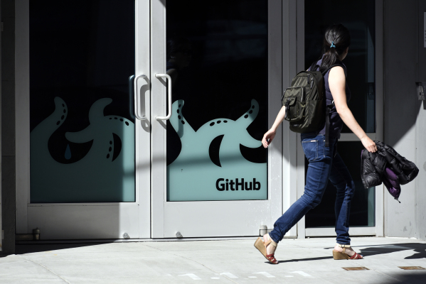 A pedestrian walks past the GitHub Inc. offices in San Francisco, California, U.S., on Monday, June 4, 2018. Microsoft Corp.is buying GitHub for $7.5 billion in stock, bringing in house a community of 28 million programmers who publish code openly and extending a shift away from a strategy of shrouding its software in secrecy. Photographer: Michael Short/Bloomberg via Getty Images