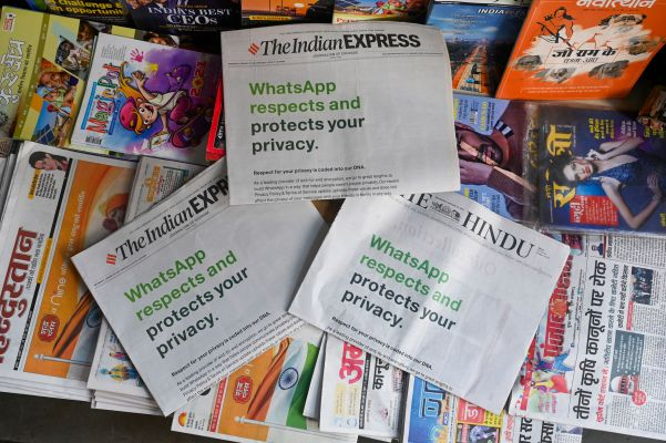 An advertisement from WhatsApp is seen in a newspaper at a stall in New Delhi on January 13, 2021. (Photo by Sajjad HUSSAIN / AFP) (Photo by SAJJAD HUSSAIN/AFP via Getty Images)